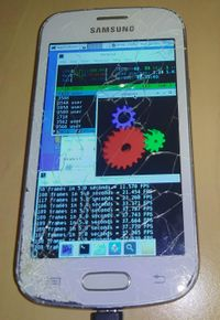 Samsung Galaxy Trend Lite (samsung-kylevess) running htop, glxgears and thunar with the XFCE4 interface