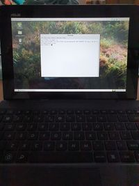 Asus TF701T in its dock, MATE desktop